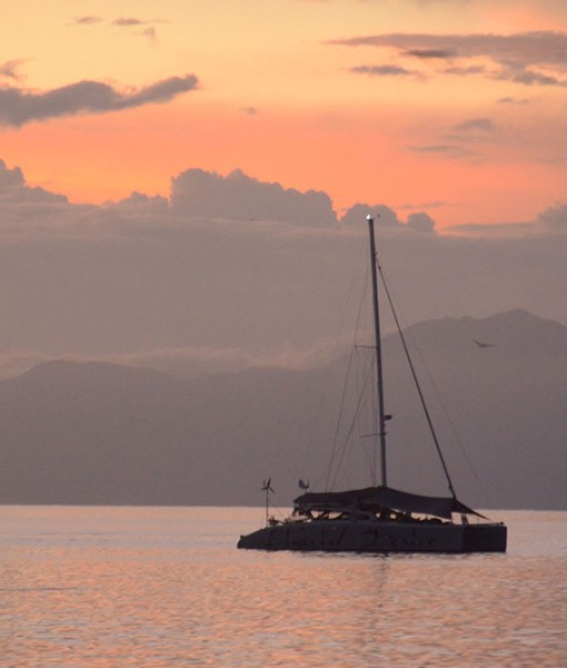 liveaboard sailing catamaran sunset